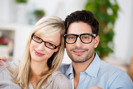 Attractive young couple wearing glasses