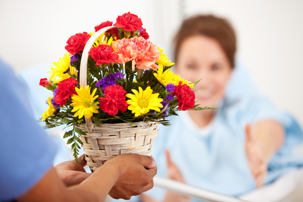 Hospital: Woman Reaches for Flower Gift