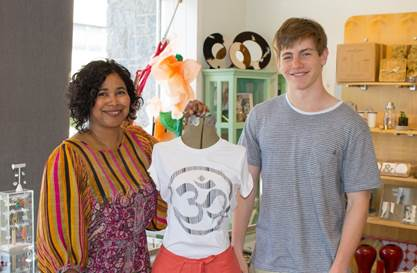 "Dawn-Marie Manwaring, owner, Beehive Designer Collective, and Horace Greeley High School student and t-shirt designer Scott Silver. Silver's ""Om"" shirt is currently being sold for $28 at the Beehive, located at 337 E. Main Street in Mount Kisco."