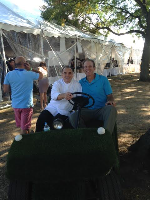 JEAN-GEORGES VONGERICHTEN and Michael Lehrer  owner of Home Green Advantage  touring the festival in Lehrer's turf covered golf cart s