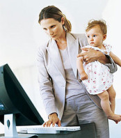 woman working and taking care of child