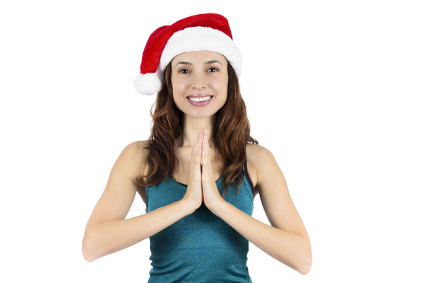Yoga Woman With Santa Claus Hat In Namaste Pose