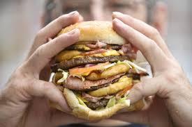 eating a huge burger
