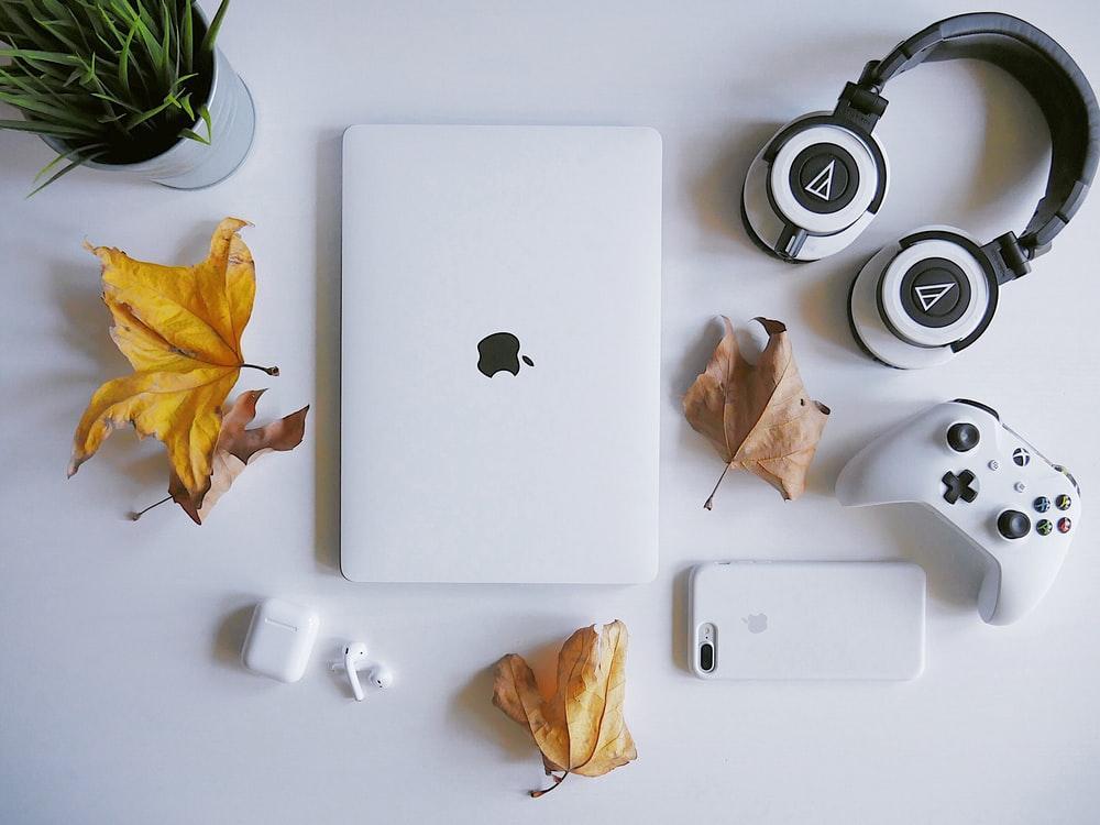 MacBook beside headphones