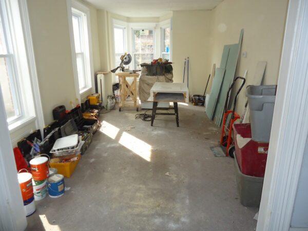 C:\Users\DELL\Downloads\Kitchen_renovation_living_room_transformed_into_workshop.JPG